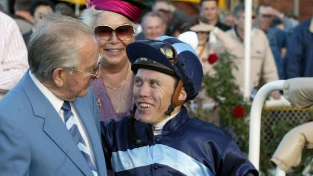 Long career: Trevor Stuckey celebrates a Reigning to Win victory with Melbourne Cup-winning jockey Chris Munce in 2006.