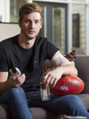 Sidelined: Alex Johnson on Thursday with his drip.