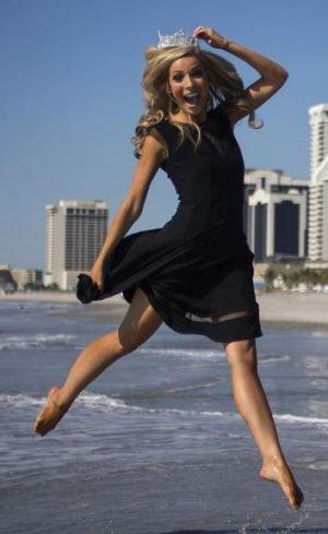 """Kira Kazantsev poses for photos during her official '""""Toe Dip"""" along the beachfront of Boardwalk Hall the morning after ..."""