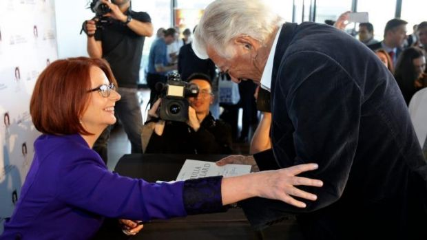 Julia Gillard reaches out to former prime minister Bob Hawke at the launch of her book in Sydney.