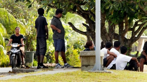 Nauru says services for asylum seekers (pictured on a brief excursion outside the processing centre) would be severely ...