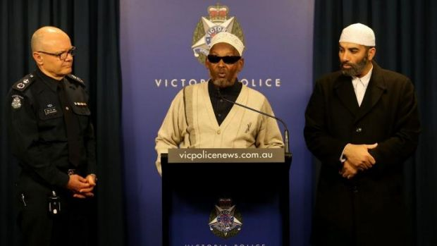 Sheikh Issa Musse (centre) and Sheikh Abdul Azim of the Australian National Imams Council with Victoria Police Chief ...