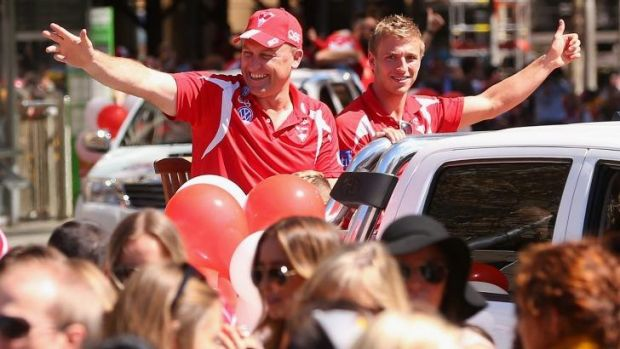 Sydney coach John Longmire and captain Kieren Jack wave to the crowd during the parade.