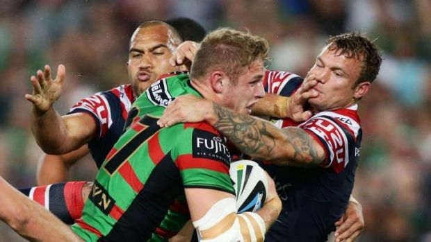 Strong-arm tactics: Tom Burgess puts a big fend on Jake Friend.