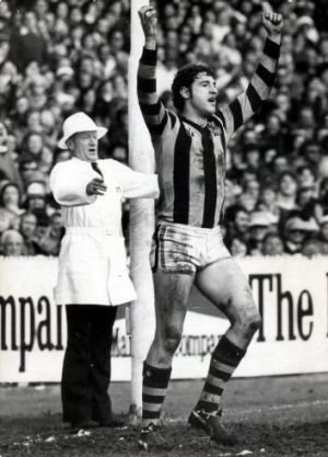 Peter Hudson salutes the effort of a teammate. Earlier he was saluted when he kicked his 100th goal for the season.