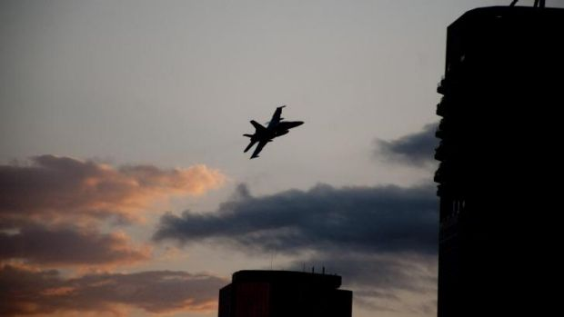 Hornet jets fly past the CBD.