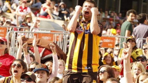 Jubilant Hawthorn fans at Federation Square on Saturday.
