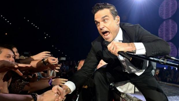 Swinging: Robbie Williams, putting on the Ritz, and then some.