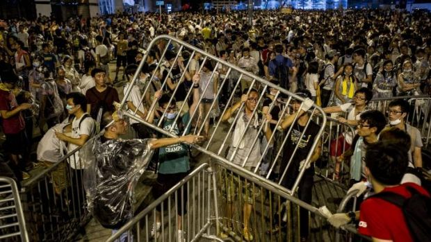 Protesters tie together barricades during pro-democracy demonstrations.