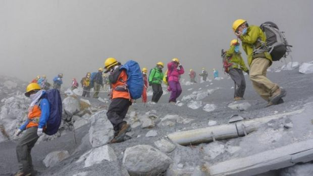 Climbers flee Mount Ontake after an eruption.