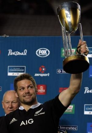 Wrapped up: New Zealand All Blacks captain Richie McCaw raises the Rugby Chapmpionship trophy.