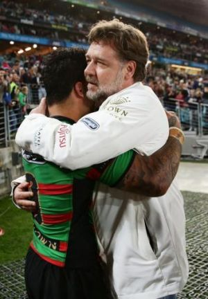 Luke celebrates after the win with Russell Crowe.