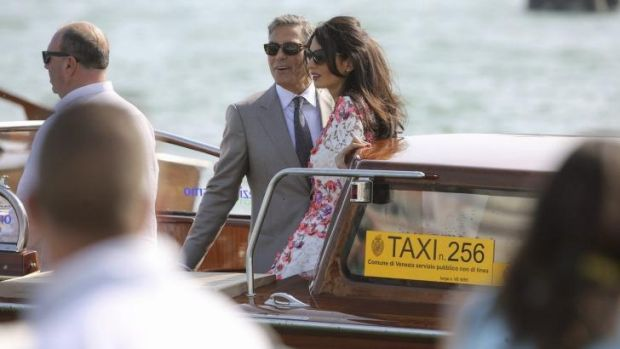 Newlyweds George Clooney and Amal Alamuddin took to the Grand Canal in Venice on Sunday.