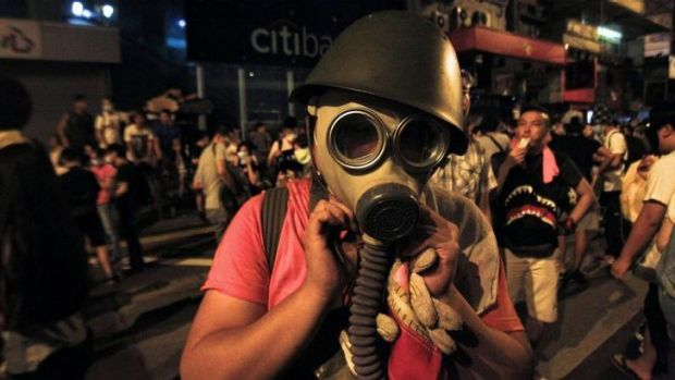 A protester puts on a gas mask to prepare for a possible tear-gas attack by police in Hong Kong.