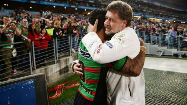 Russell Crowe embraces Issac Luke of the Rabbitohs after the first preliminary final between the Rabbitohs and the ...