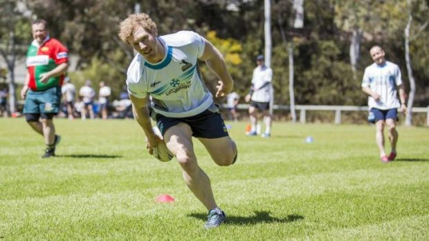 David Pocock scores a try during the touch football tournament near Parliament House.