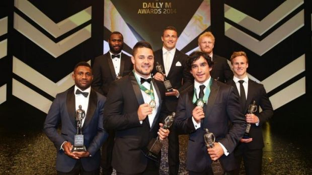 Jarryd Hayne and Johnathan Thurston pose with the Team of the Year at the Dally M Awards.