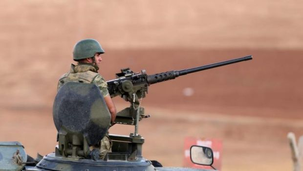 A Turkish soldier guards the Syrian border.