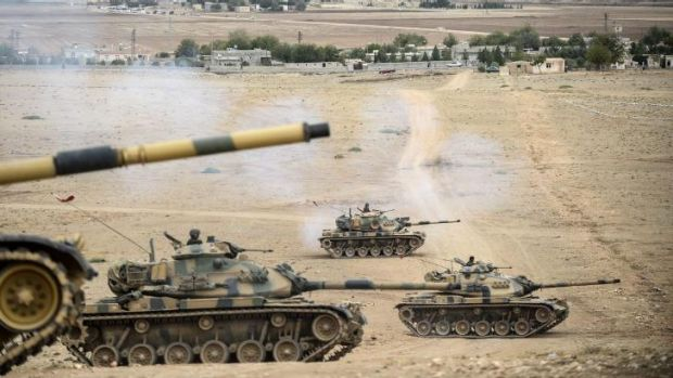 Expanding war front: Turkish army tanks take position near the Syrian border against the oncoming Islamic State.