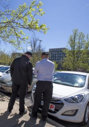 Two parking officers, who do not wish to be identified, conduct their rounds in parliamentary triangle car parks on the ...