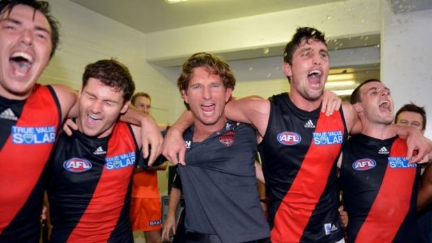 In happier times: James Hird celebrates with his players after a narrow win.