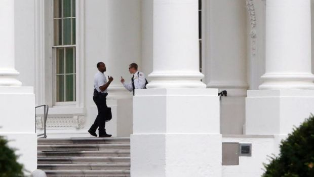 Under pressure: Members of the US Secret Service patrol the White House.