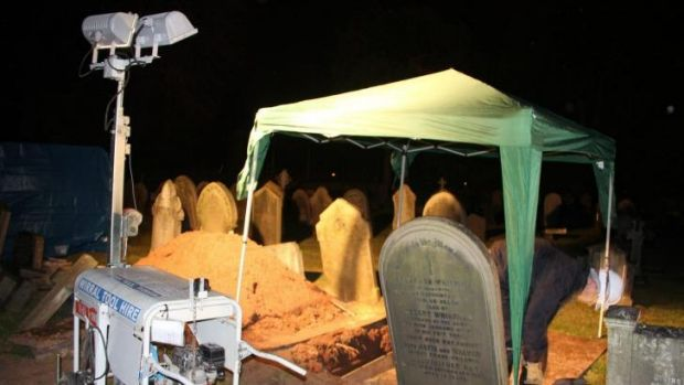 In the dark: The exhumation of the grave of Thomas Bailey, Fred Deeming's brother, in May.
