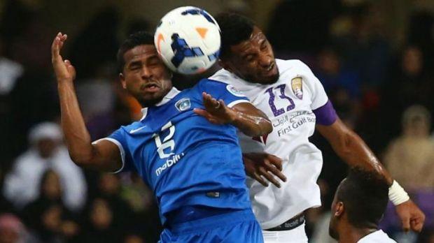 Saudi's al-Hilal forward Nasser Al-Shamrani vies for the ball with UAE's al-Ain defender Mohamed Ahmed during their AFC ...