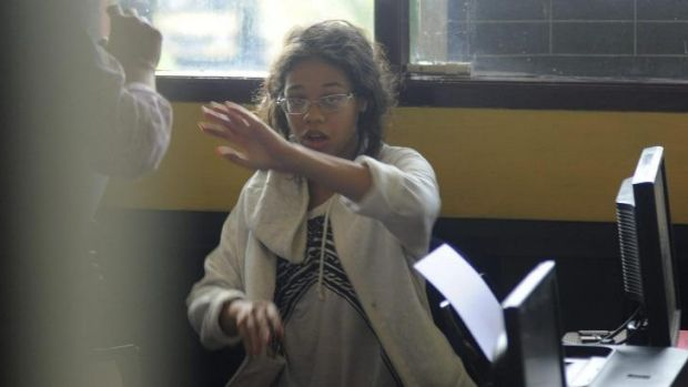 Heather Mack in custody at a police station in Denpasar.