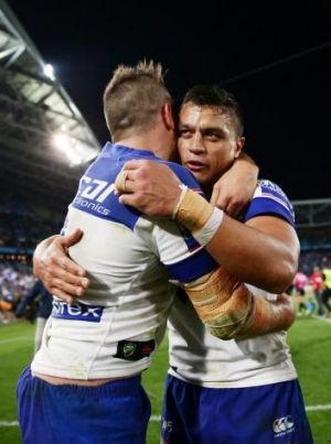 Josh Reynolds hugs Sam Perrett after the victory over the Panthers.