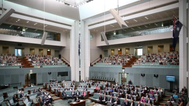 The glass-enclosed public gallery above Parliament's House of Representatives, where women with head coverings would ...