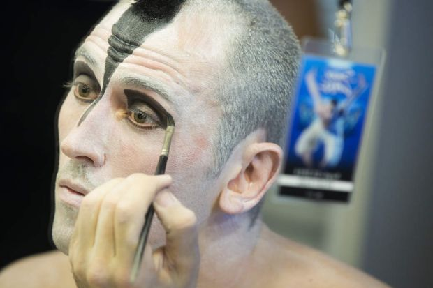 Chris Trenfield applies make-up for his role in Matthew Bourne's Swan Lake.