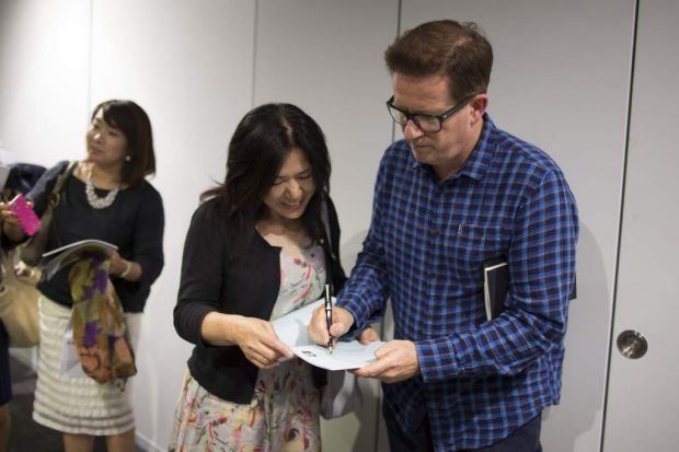 Matthew Bourne signs autographs outside Tokyo's Orb Theatre.