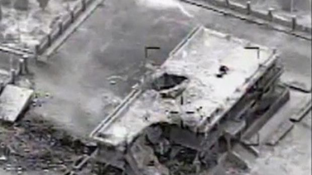 A still image taken from video provided by the US Central Command shows a damaged building at an Islamic State compound ...