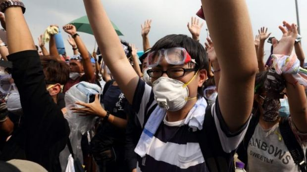 Prepared for the worst: Students don masks to protect themselves against tear gas.