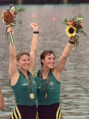 Australia's Gold medalists Megan Still (L) and Kate Slatter (R) in the women coxless pairs celebrate during the medals ...