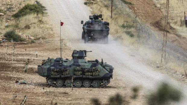 Turkish tanks man a position facing the Islamic State fighters 10 kilometres west of Kobane.