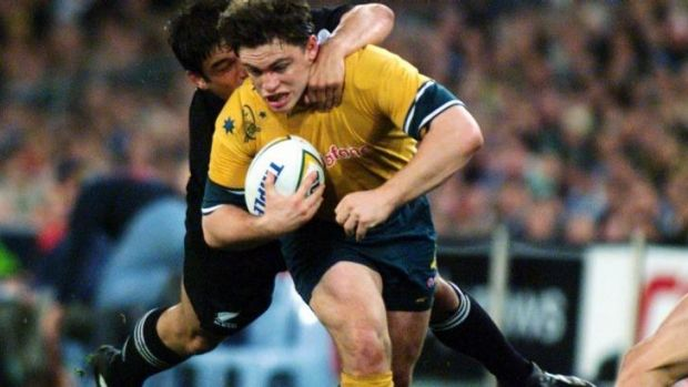 Action man: Wallaby utility Rod Kafer in the thick of the fray against the All Blacks in 1999.