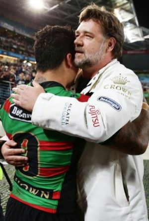 Master and Commander: Issac Luke (left) and Russell Crowe embrace after the preliminary final victory over Sydney Roosters.
