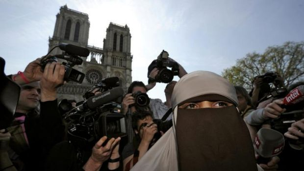 Kenza Drider, a French Muslim of North African descent, wears a niqab outside the Notre Dame Cathedral in Paris just ...