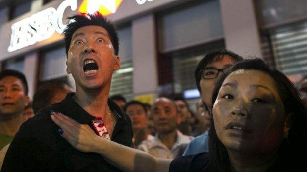 """Residents of Kowloon who are pro-Beijing scream at the student democracy protesters to """"get out"""" in the Mong Kok ..."""