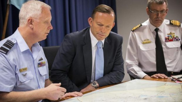 Top brass: Tony Abbott receives a briefing at Defence headquarters.