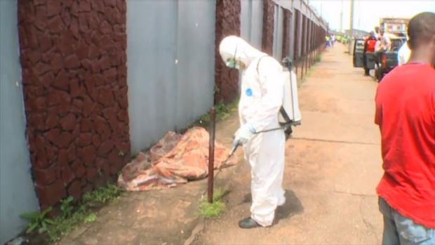 The body of a man, believed to be dead, is doused in bleach. <i>Source: ABC News</i>