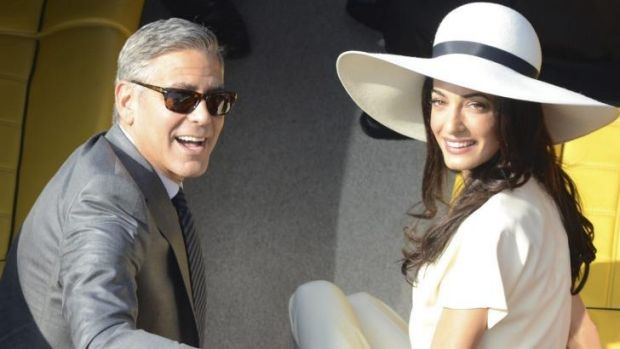 George Clooney and his wife Amal Alamuddin leave the city hall after their civil marriage ceremony in Venice, Italy.