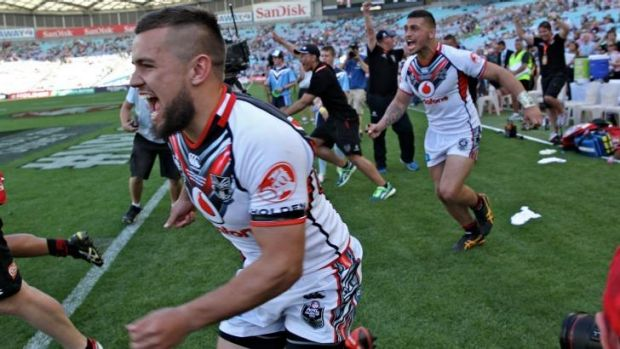 That's settled: Warriors players let off steam after beating the Broncos.