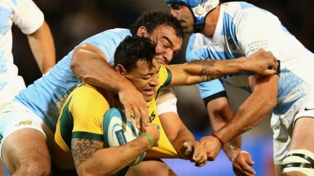 Stranglehold: Israel Folau is tackled during the Wallabies' upset loss to the Pumas.