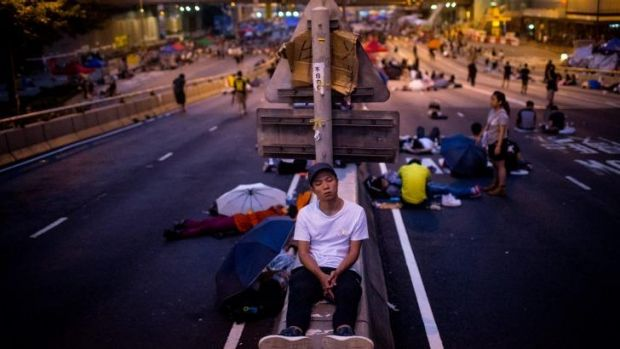 Democracy protestors sleep on the streets ahead of an ultimatum from Hong Kong authorities to open roads.