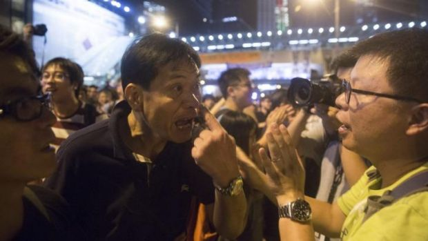 Demonstrators argue with each other outside the central government offices in Hong Kong.