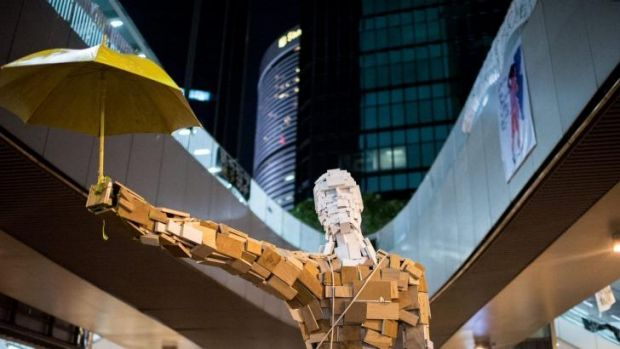"""The statue """"Umbrella Man"""" by the Hong Kong artist known as Milk, is set up at a pro-democracy protest site next to the ..."""