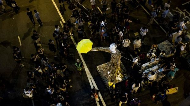Umbrella Man by the Hong Kong artist known as Milk stands at a pro-democracy protest site next to the central government ...